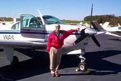 A CFI pauses beside his student's plane after a successful session.